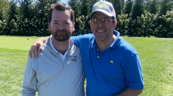 two men smiling at golf course