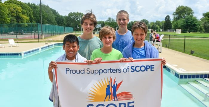 Campers holding SCOPE banner