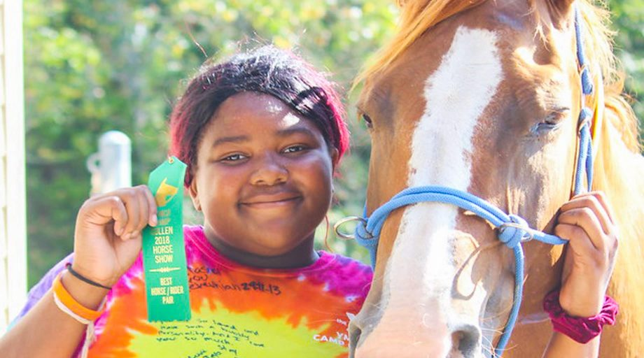Camper with award and horse