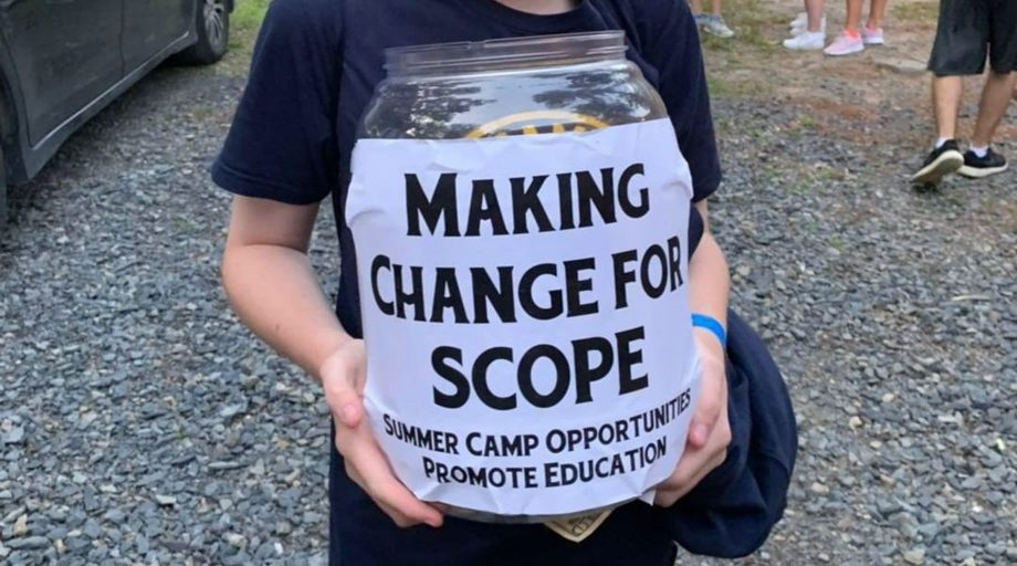 "hands holding bucket labeled ""Making Change for Scope"""