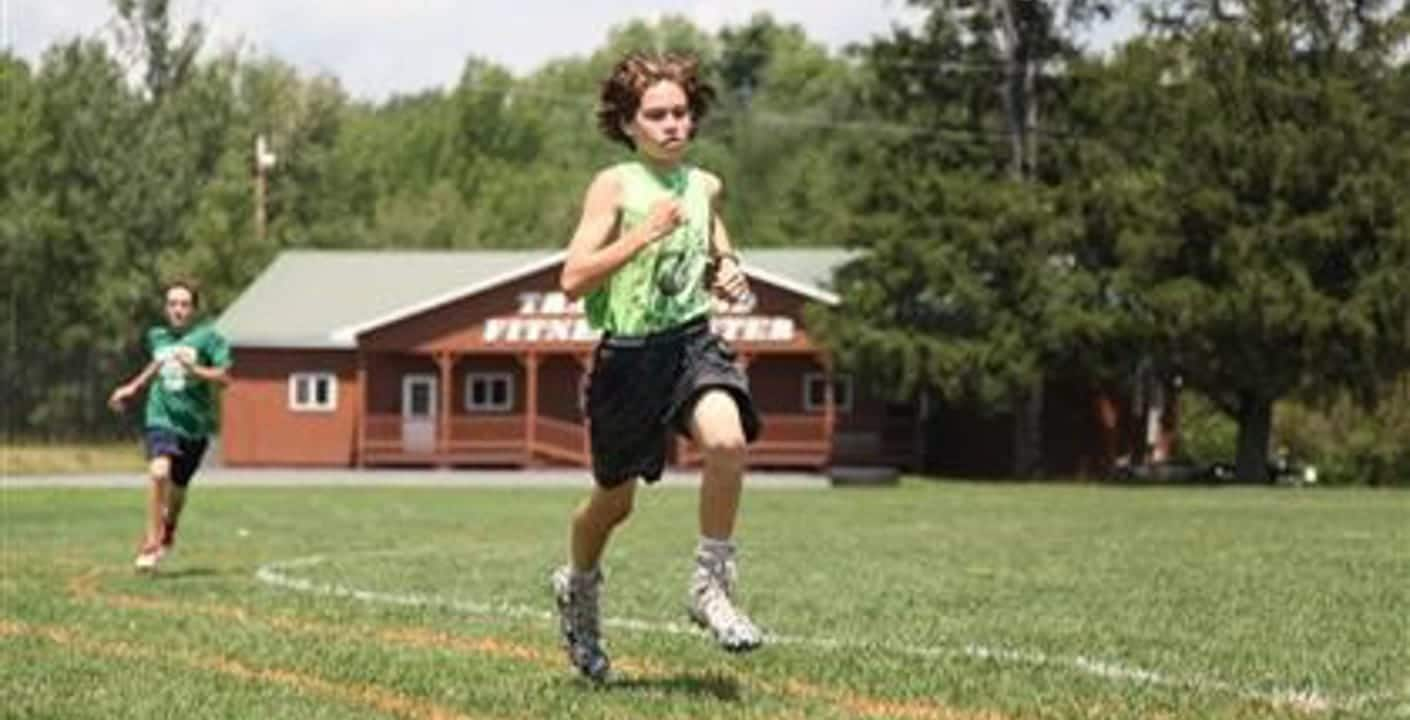 Sam Mullen playing sports at camp