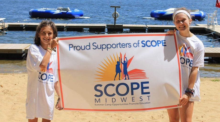 Girls with SCOPE Midwest Swimathon sign