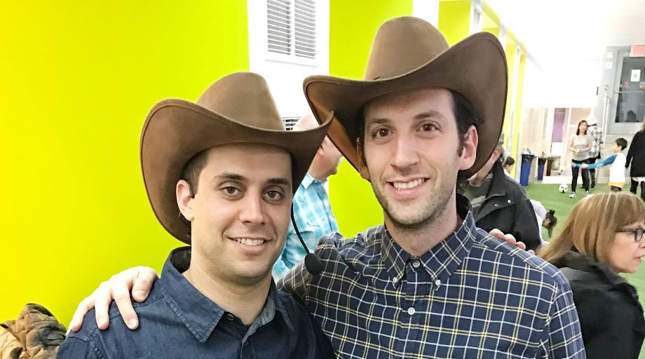Men wearing cowboy hats at square dance event