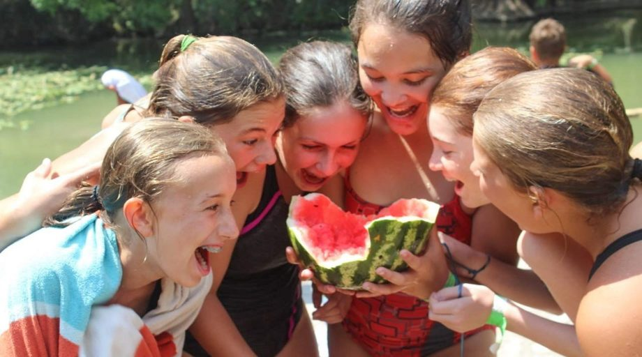 YMCA girls eating watermelow