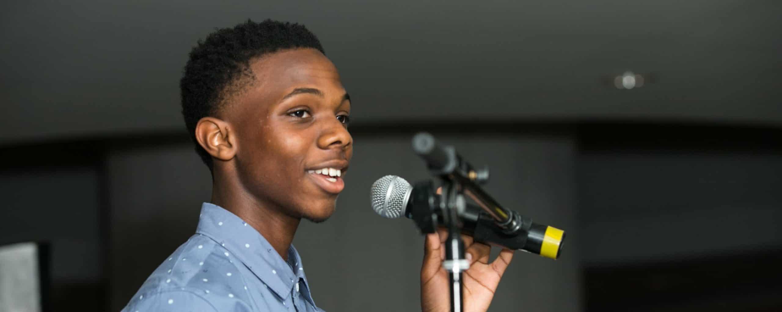boy using microphone