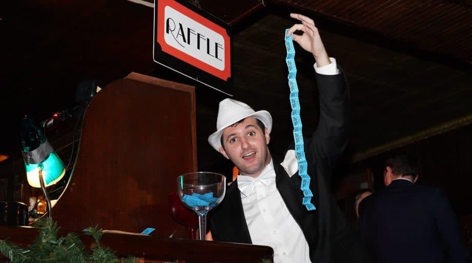 man holding raffle ticket