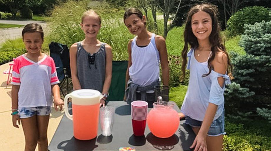 Youth selling lemonade