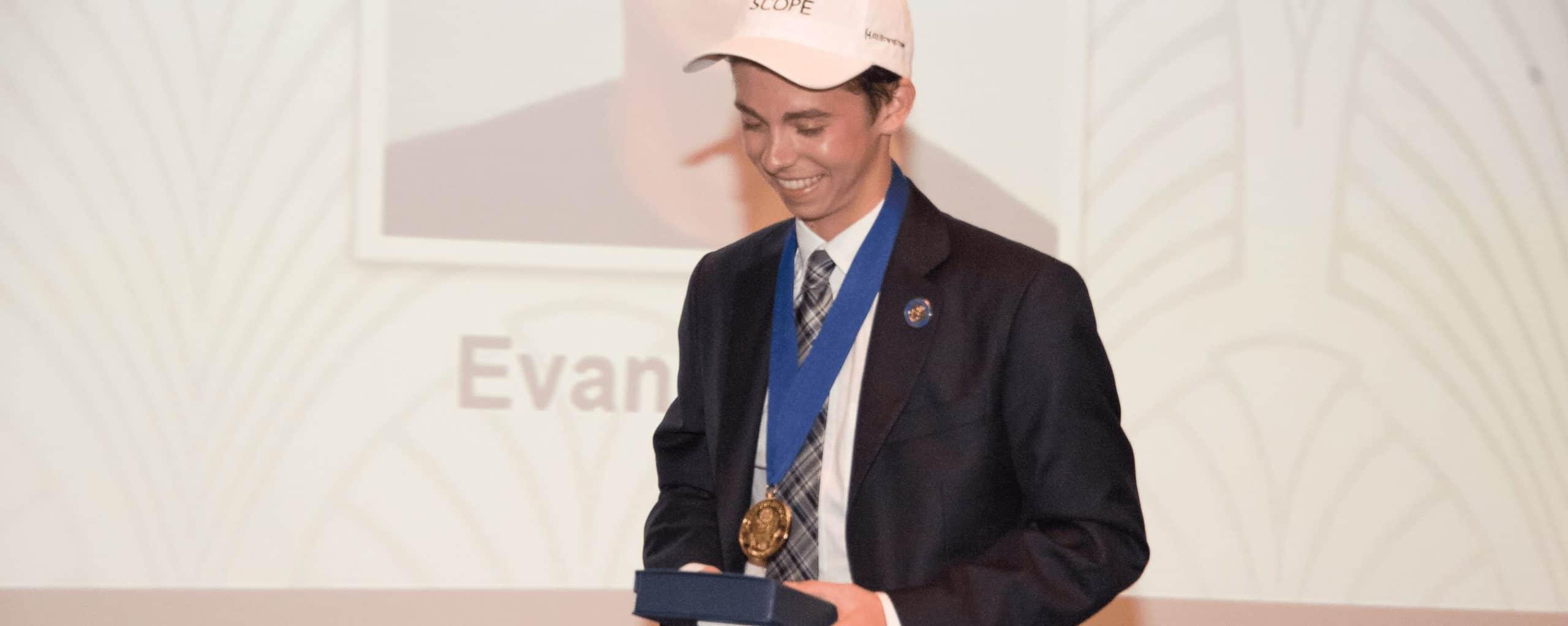 Evan receiving award