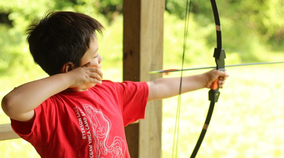 Camper shooting archery arrow
