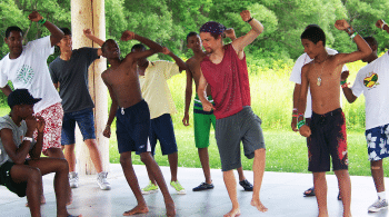 group of teens dancing outside