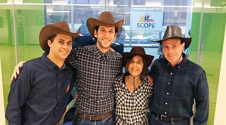 Jay Jacobs and team in cowboy hats