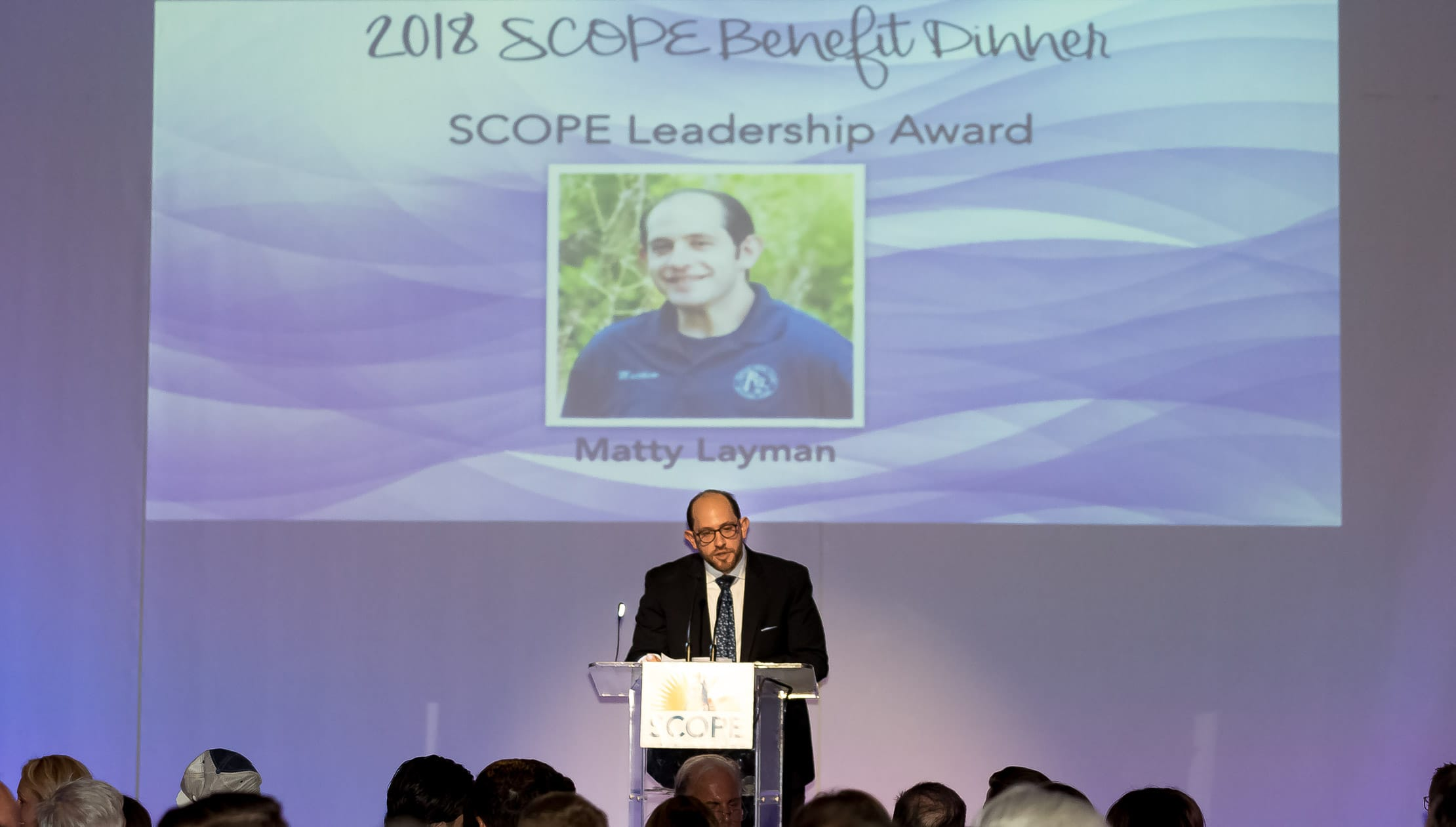 Matty speaking at SCOPE Benefit Dinner