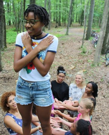 teens doing trust fall at summer camp