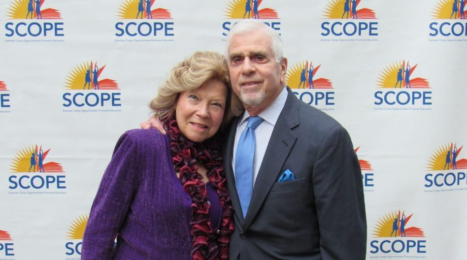 man and woman smiling at SCOPE event