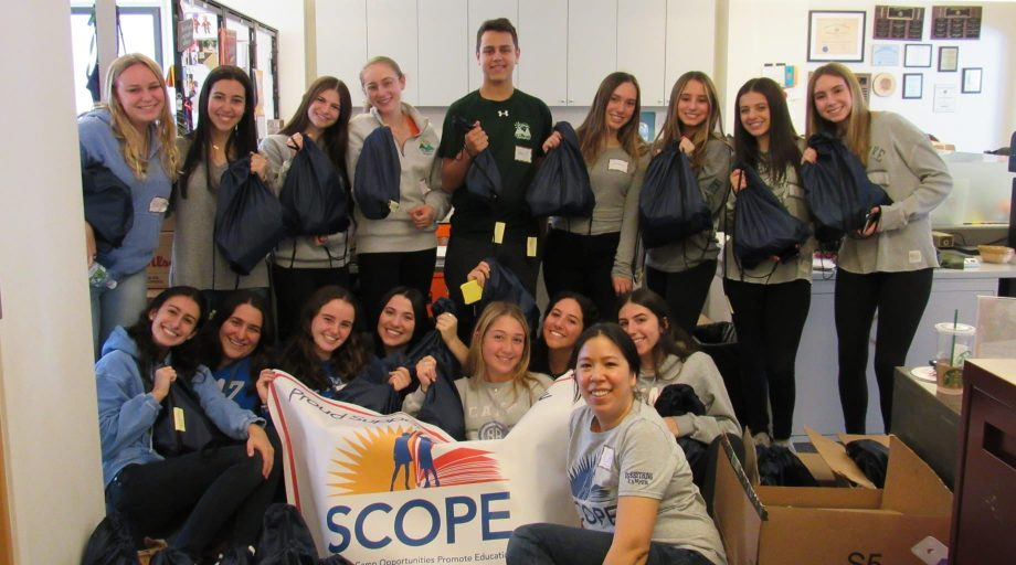 Group of staff members holding the SCOPE banner