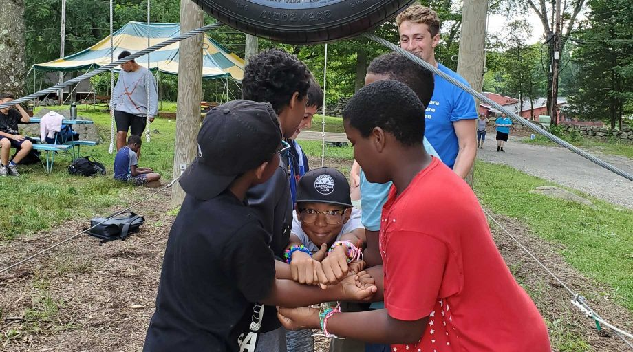 Boys at Camp Vacamas doing a team building exercise