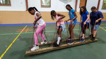 Girls doing team building exercises at Vacamas