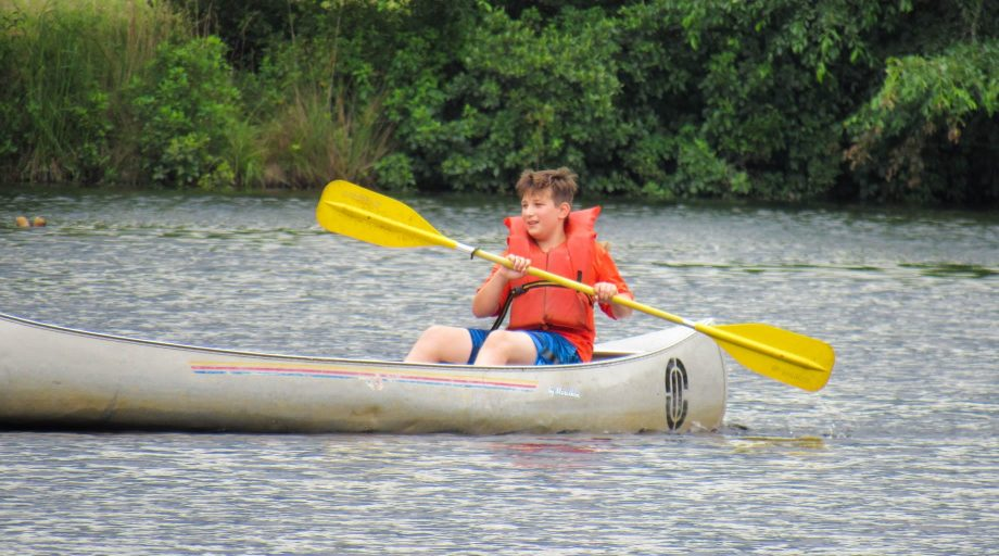 Camper canoeing at YMCA of the Pines