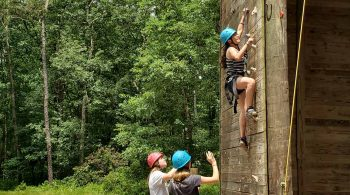 Girls at YMCA of the Pines on the climbing tower