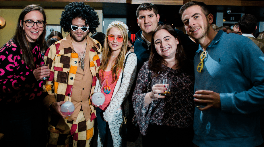 camp counselors dressed up as 70s disco
