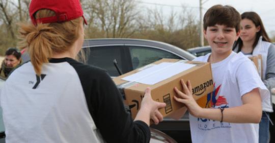 boy receiving Amazon package