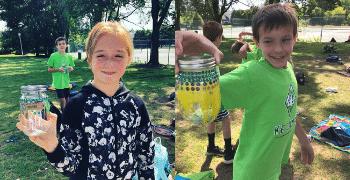 kids holding giving jars at summer camp