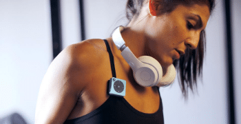 woman with headphones on neck while exercising