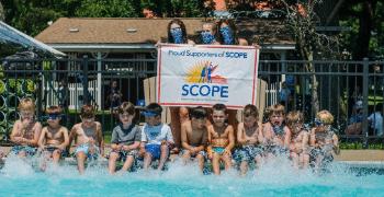kids splashing around in pool at camp